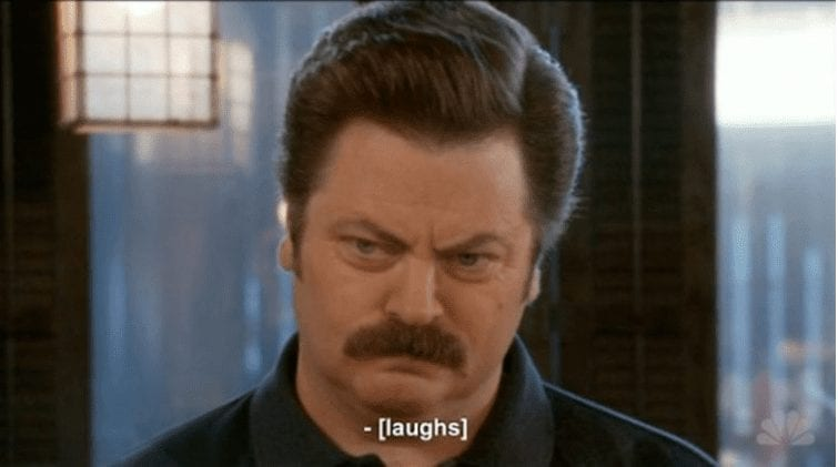 Ron Swanson from Parks and Rec scowling with inaccurate caption saying laughs