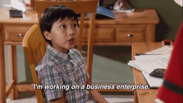 "Meme of small child reading ""I'm working on a business enterprise"""