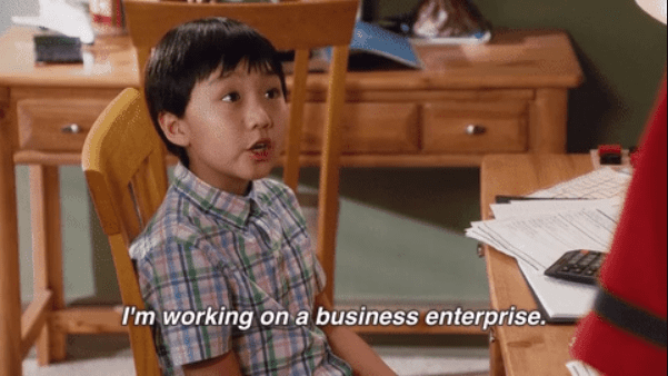 """Meme of small child reading """"I'm working on a business enterprise"""""""