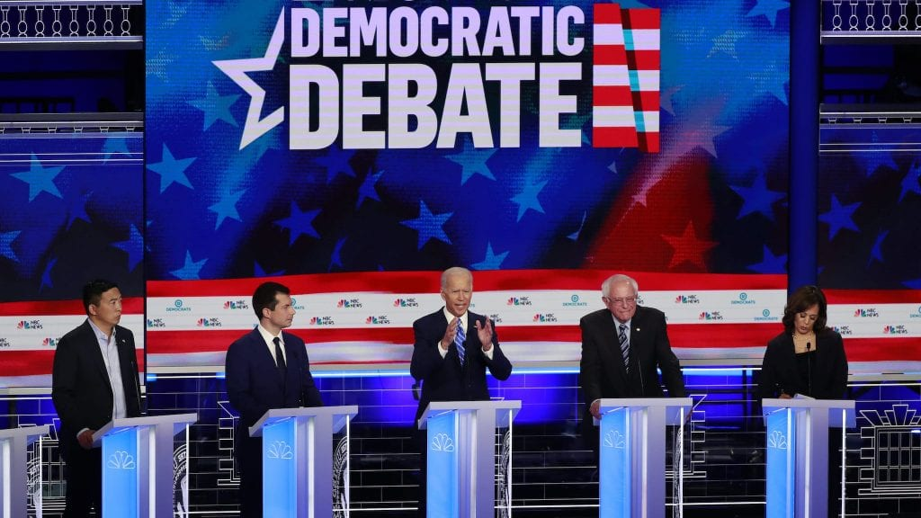 Democratic presidential candidate former Vice-President Joe Biden, center, speaks during the Democratic primary debate hosted by NBC News at the Adrienne Arsht Center for the Performing Art,  Thursday, June 27, 2019, in Miami. (AP Photo/Wilfredo Lee)